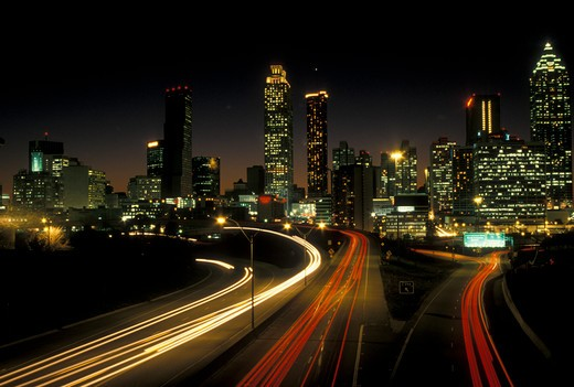 Stock Photo: 4286-20182 skyline, Atlanta, GA, Georgia, Traffic lights streak on Freedom Parkway in the evening and skyline of downtown Atlanta.