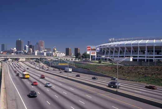 Stock Photo: 4286-20208 expressway, Atlanta, skyline, GA, Georgia, Skyline of Atlanta and Fulton County Stadium. Traffic on interstate I-85/75 in Atlanta.