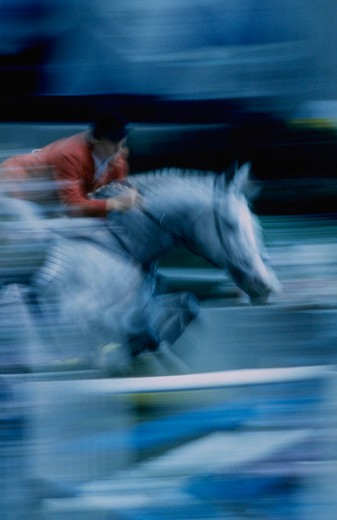 Stock Photo: 4286-20798 Jumping horse blurred