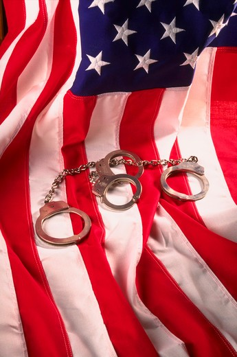 American flag and handcuffs : Stock Photo