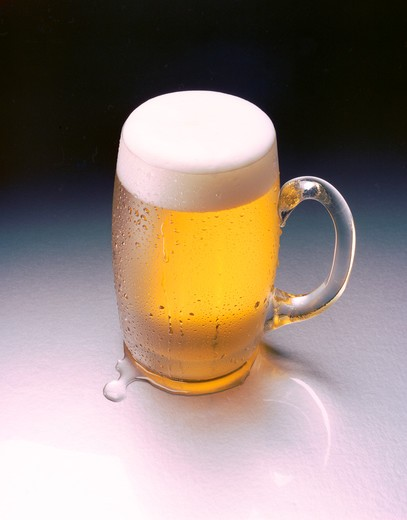Glass mug filled with golden beer with nice foamy head. : Stock Photo