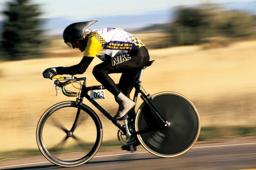 Stock Photo: 4286-21197 Speed-blurred image of racing Senior Games bicyclist, Enterprise, Utah.