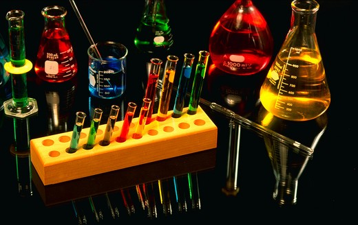 Stock Photo: 4286-21278 Assortment of chemical glassware on mirror.