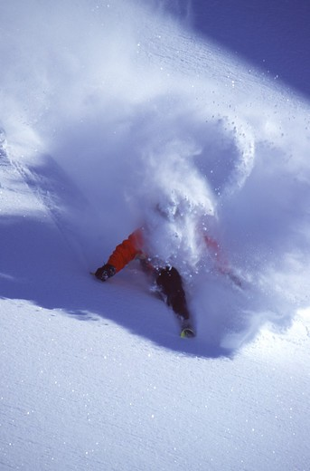 A man skiing powder in the Chugach Mountains, AK : Stock Photo