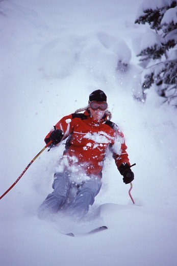Stock Photo: 4286-21843 A woman skiing powder at Alpine Meadows, CA.