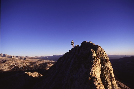 A man mountaineering on Bear Creek Spire, CA. : Stock Photo