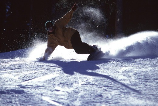 Snowboarding on a sunny day iin the Wasatch mountains in Utah. : Stock Photo