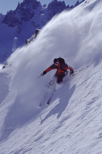 Stock Photo: 4286-22604 A man skiing powder snow in Chamonix, France.