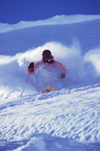 A man skiing powder snow in the Chugach mountains of Alaska. : Stock Photo