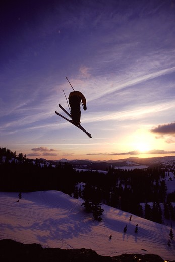 A man jumping on skis at Squaw Valley in California. : Stock Photo