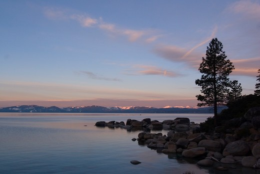 The west shore of Lake Tahoe at dawn from the east shore : Stock Photo