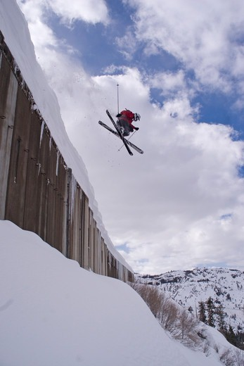 Stock Photo: 4286-22748 A man skiing off a train shed above Donner Lake California