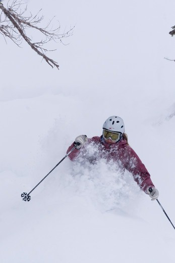 A woman skiing deep powder snow in a storm Alpine Meadows in Lake Tahoe, California : Stock Photo