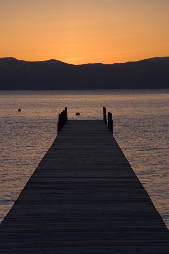Stock Photo: 4286-22862 A boat dock on Lake Tahoe at sunrise.
