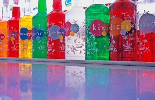different colored bottles of flavored drink syrup : Stock Photo