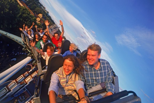 People flying around on roller coaster  : Stock Photo