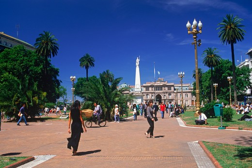 People and statue at Plaza de Mayo in Buenos Aires : Stock Photo