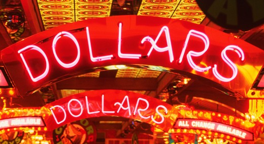 Dollars illuminated in neon lights : Stock Photo