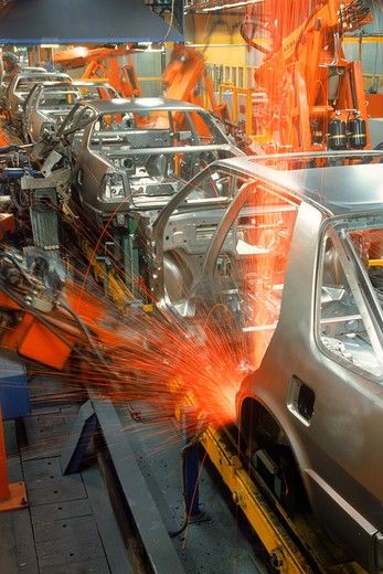 Stock Photo: 4286-26101 Sparks flying from robatic spot welding at SAAB Scania plant in Sweden