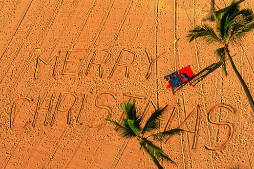 Stock Photo: 4286-26284 Merry Christmas written on sandy beach in Hawaii