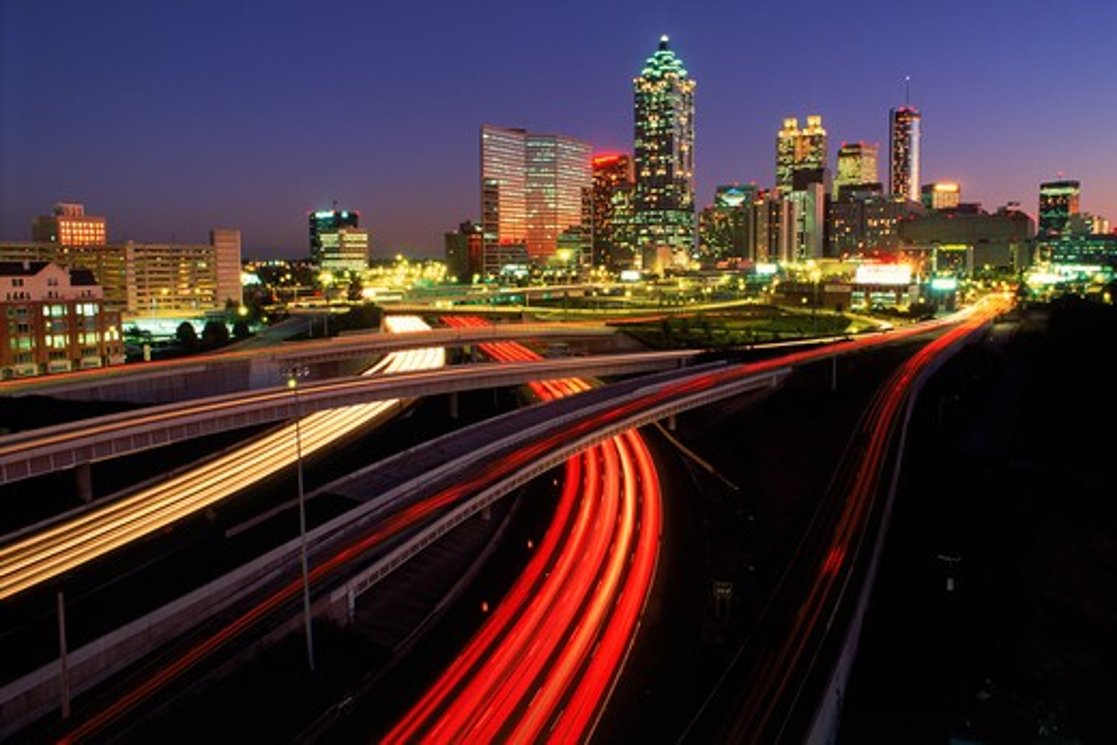 Highways leading into Atlanta at dusk : Stock Photo
