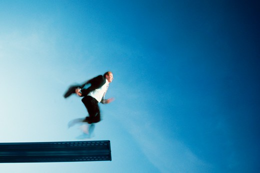 Stock Photo: 4286-26522 Businessman about to run off diving board