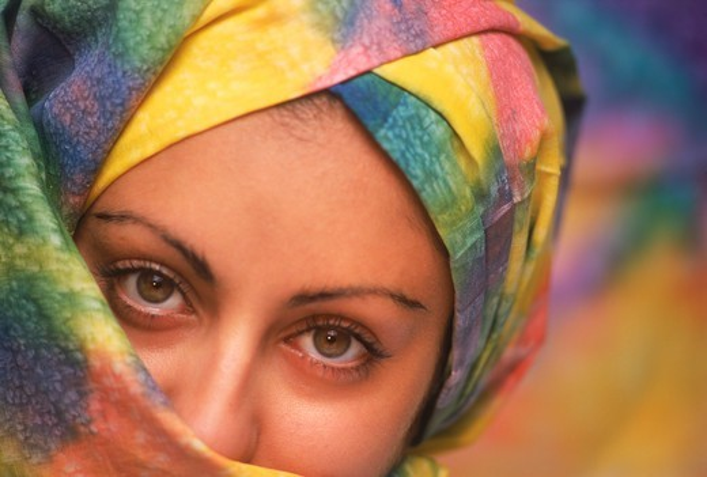 Arabian woman wearing colorful veil : Stock Photo