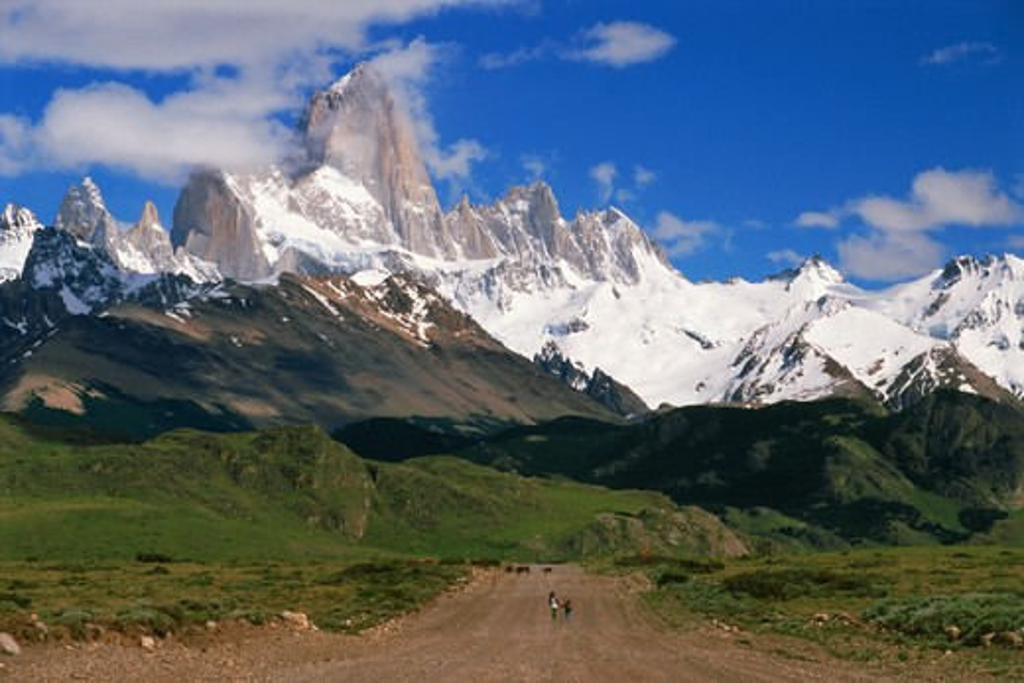 Two children on road to El Chalten under Fitz Roy peak 3440 m in Los Glaciares National Park Santa Cruz province Patagonia  : Stock Photo