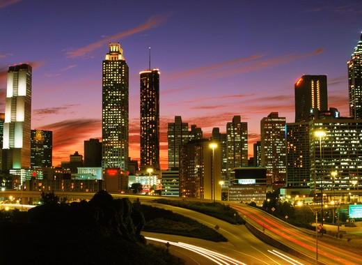 Stock Photo: 4286-27780 Highways leading into and out of Atlanta at dusk under city skyline