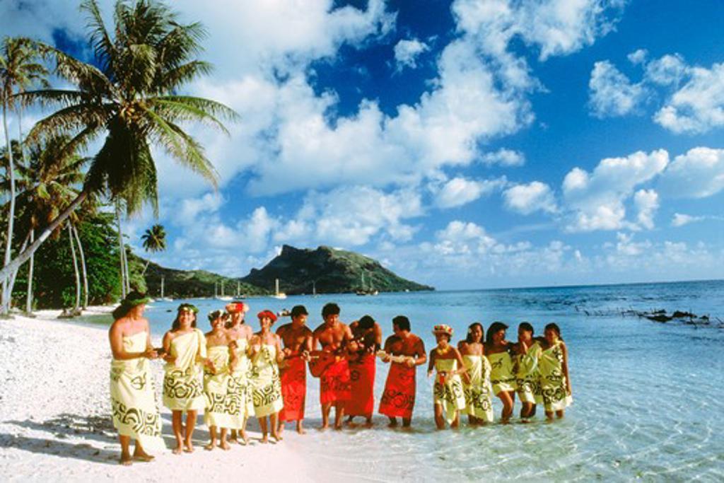 Traditional island dress of French Polynesians on Bora Bora beach in Society Islands : Stock Photo