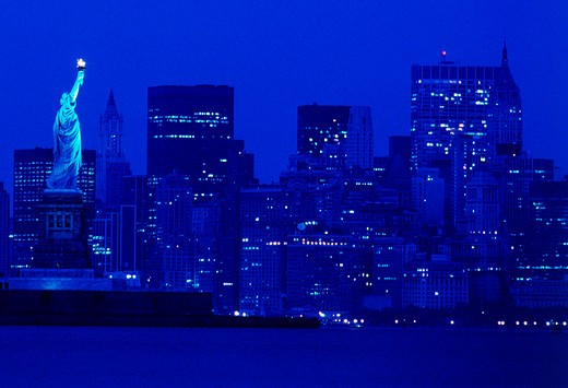 Stock Photo: 4286-27868 NIGHT TIME SKYLINE OF NEW YORK CITY AND STATUE OF LIBERTY