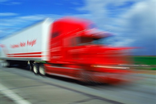 Stock Photo: 4286-27904 Red truck cab and trailer speeding along California highway