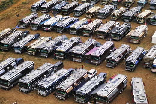 Stock Photo: 4286-28100 Rows of big expensive RVs in parking lot at Albequerque Balloon Festival in New Mexico