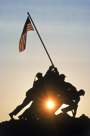 Stock Photo: 4286-28138 US Marine Corps War Memorial silhouetted in Arlington National Cemetery