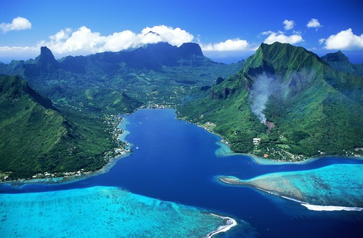 Stock Photo: 4286-28692 Aerial view of Cooks Bay and mountains on Island of Moorea swimming between blue skies and blue ocean