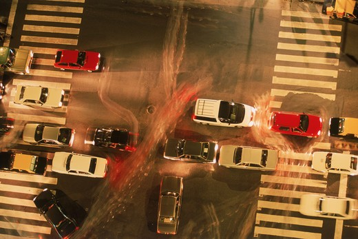 Stock Photo: 4286-28903 Intersection traffic at night from above