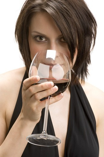 Stock Photo: 4286-29363 Woman with a snifter of alcoholic beverage