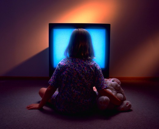 Stock Photo: 4286-29590 Young girl mesmerized by t.v.