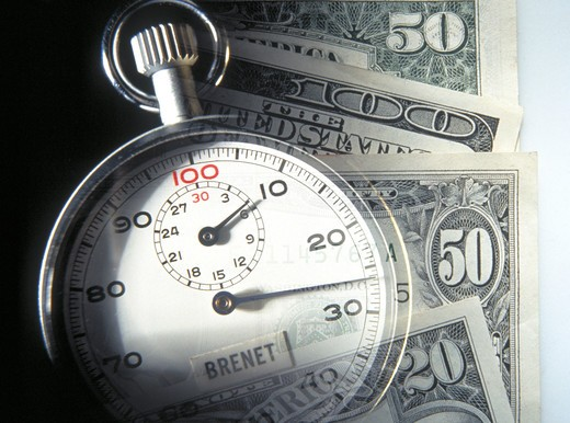Stock Photo: 4286-29700 US currency and stopwatch