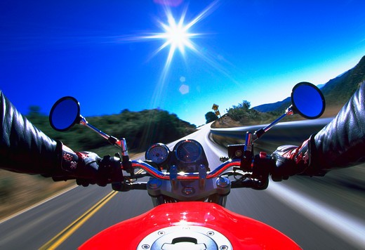 Stock Photo: 4286-29775 Blurred view as a motorcyclist speeds down a road.