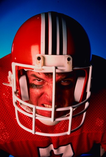 Stock Photo: 4286-30229 Close-up of angry football player wearing helmet and jersey.