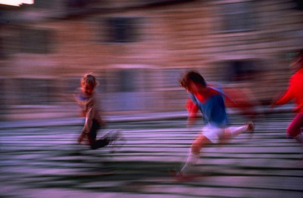 Kids playing, blurred : Stock Photo