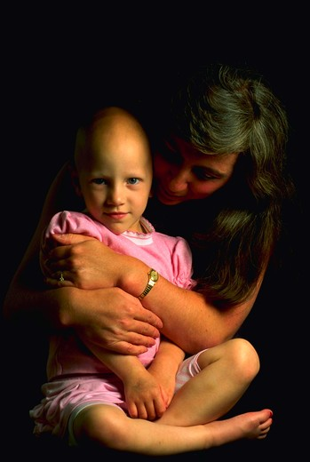 Holding on to life. A young cancer patient and her mother. Chemotherapy treatment. : Stock Photo
