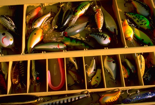 Variety of colorful bass lures in tackle box. : Stock Photo