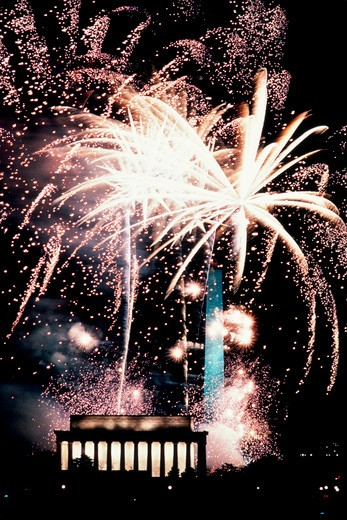 Stock Photo: 4286-30876 Brilliant fireworks bursting over the Lincoln Memorial and Washington Monument, George H.W. Bush inauguration celebration, 1989.