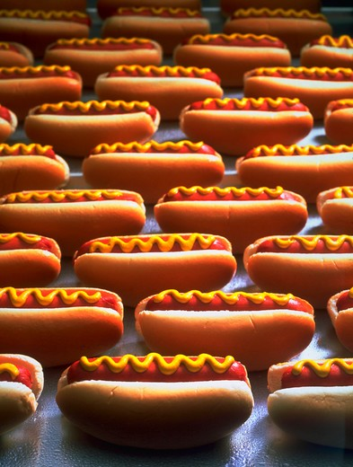 Stock Photo: 4286-31368 Still life of several hot dogs in buns with mustard.