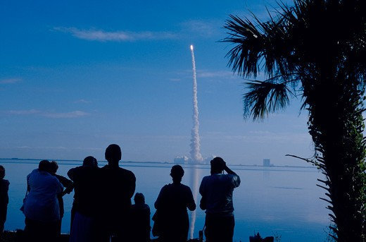 Stock Photo: 4286-31481 Spectators watch the final launch of the shuttle ?Columbia? across the Indian River at the Kennedy Space Center, FL 1-16-03.