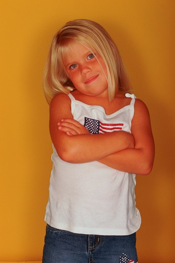 Stock Photo: 4286-31854 Studio shot of a young, blonde girl posing for the camera.