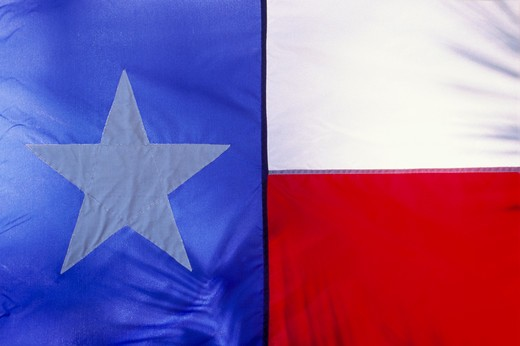 Close-up of the Texas State Flag displaying red, white, and blue and a large white star. : Stock Photo