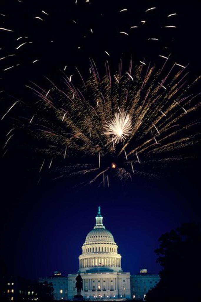 Stock Photo: 4286-32061 Double exposure shot of fireworks bursting over U.S. Capitol dome, Washington, DC.